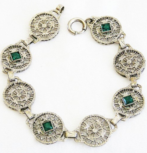 Edwardian bracelet with filigree and emerald green glass. Circa 1920's. Via Diamonds in the Library.