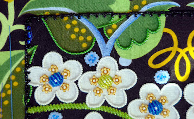 Detail: Assorted leaves at the top of Wild Child with their completed beaded outlines. (Wild Child Japanese Bead Embroidery by Mary Alice Sinton)