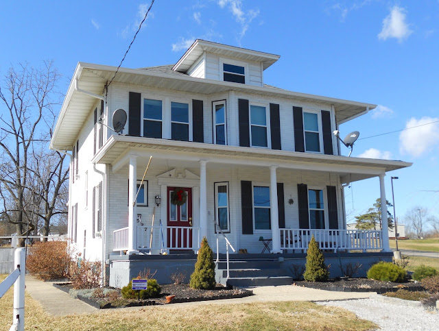 white 2-story house with black shutters: Aladdin Charleston at 10527 Hamilton Avenue Cincinnati Ohio