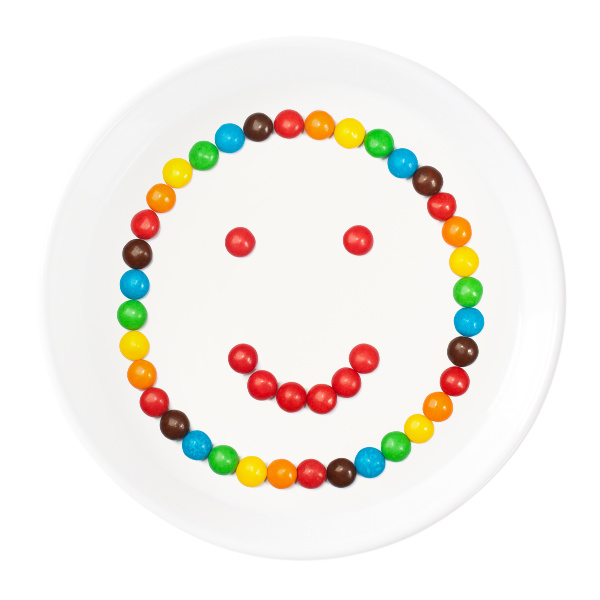 smiley face made out of skittles for kids science experiment