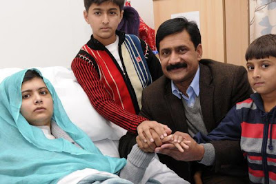 Malala with her father in England