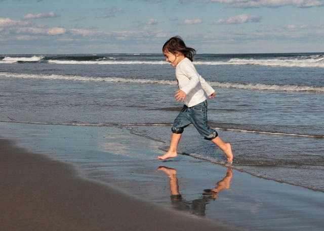 NAMC montessori psychic developing personality early childhood girl running on beach