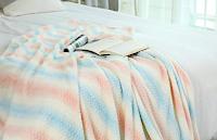 Logo Songmics Giveaway d'Inverno: vinci gratis una morbida coperta