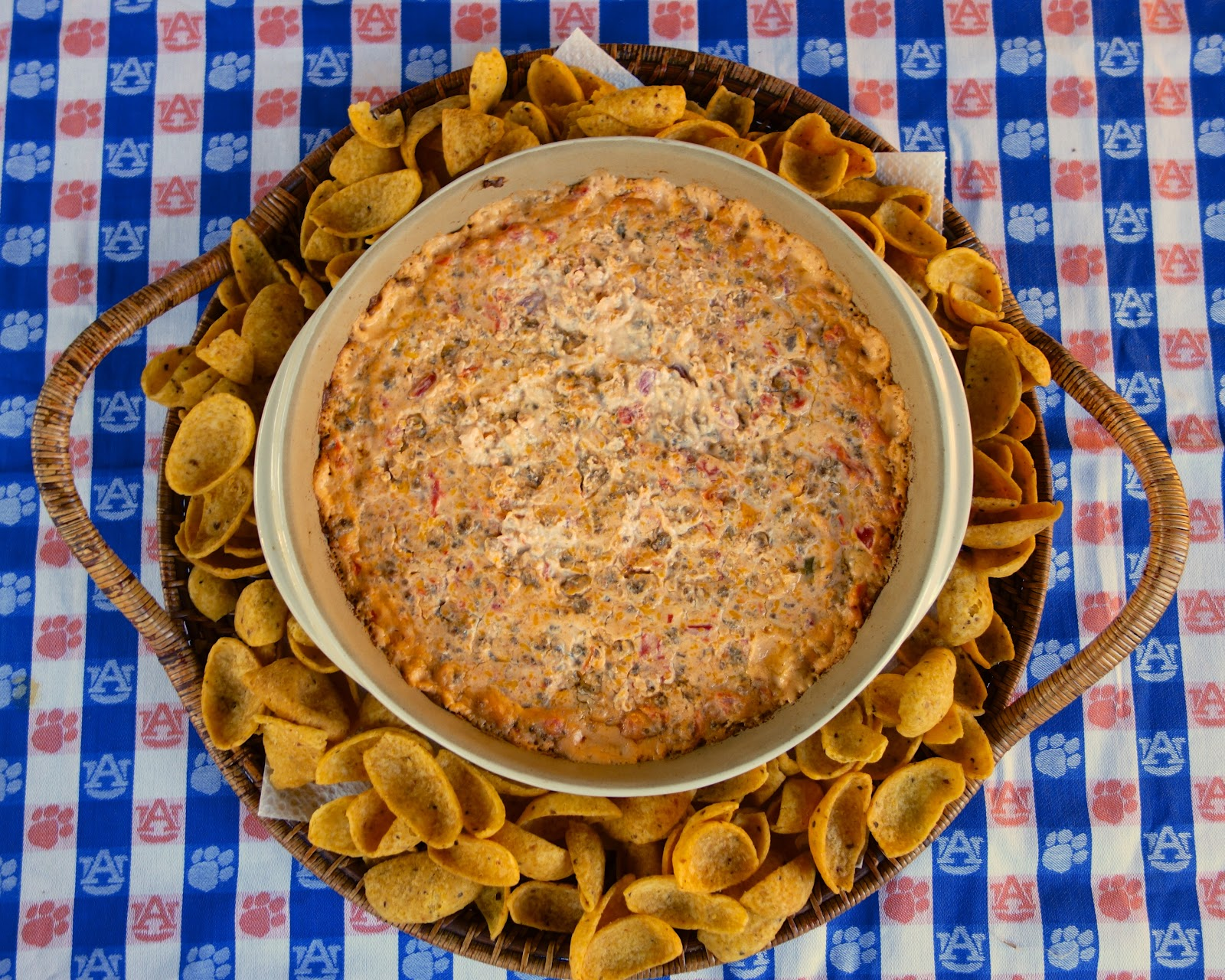 Hot Sausage Dip - always the star of our parties! Can make ahead and bake when ready. Seriously delicious!! Hot sausage, cream cheese, sour cream, cheddar cheese, diced tomatoes with green chiles. Serve with tortilla chips or corn chips. Everyone LOVES this yummy dip!!