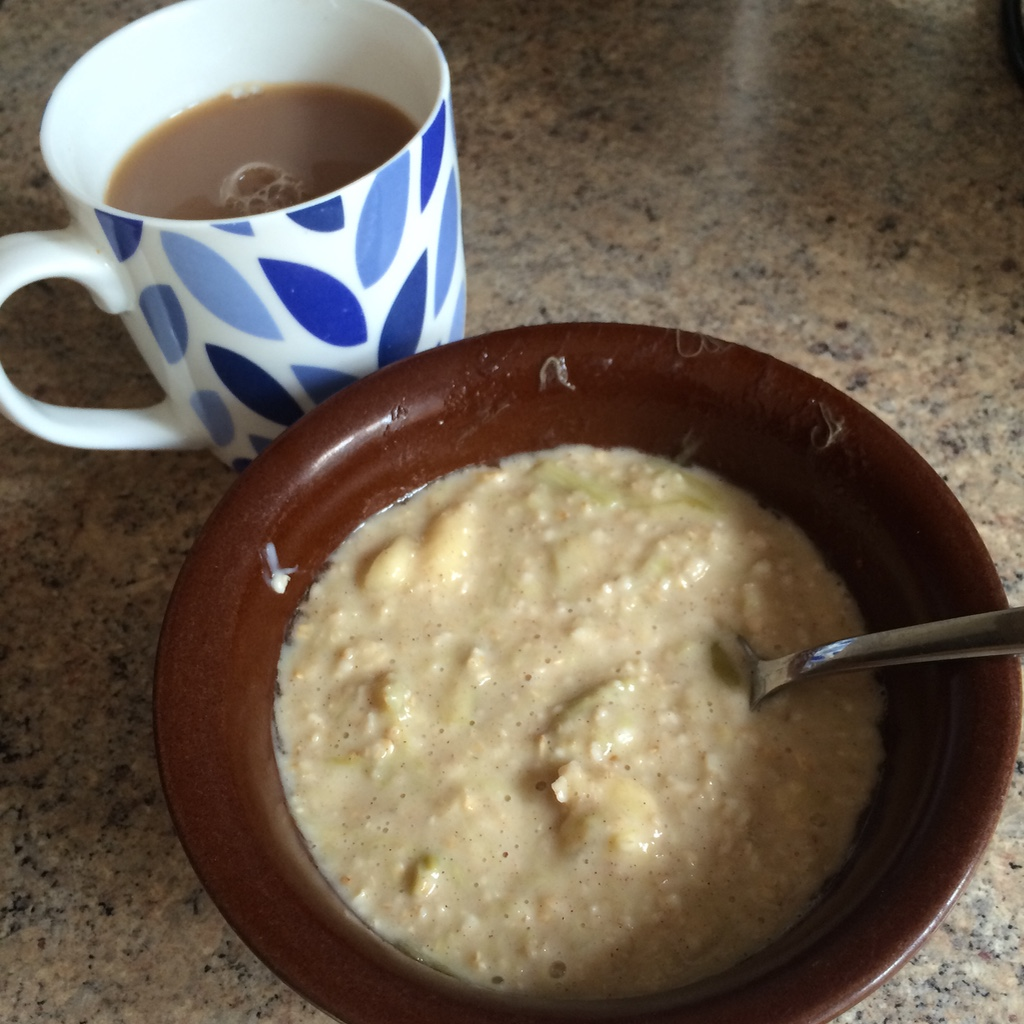 Porridge with rhubarb and banana and a cup of tea