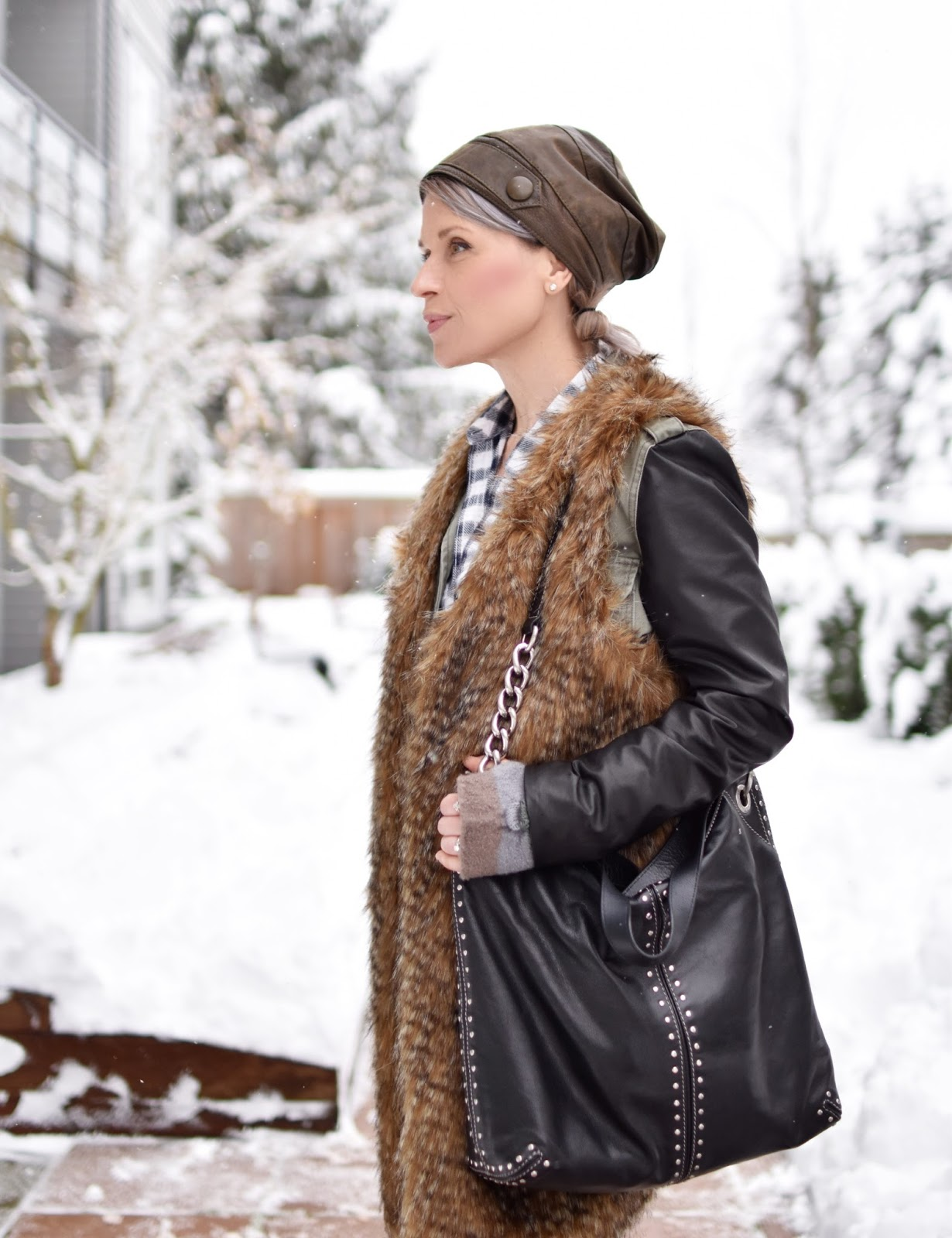 Monika Faulkner outfit inspiration - plaid shirt, military parka, long faux-fur vest, leather beanie, MK bag