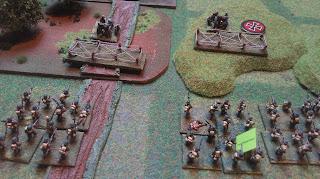 German field guns face off against British infantry