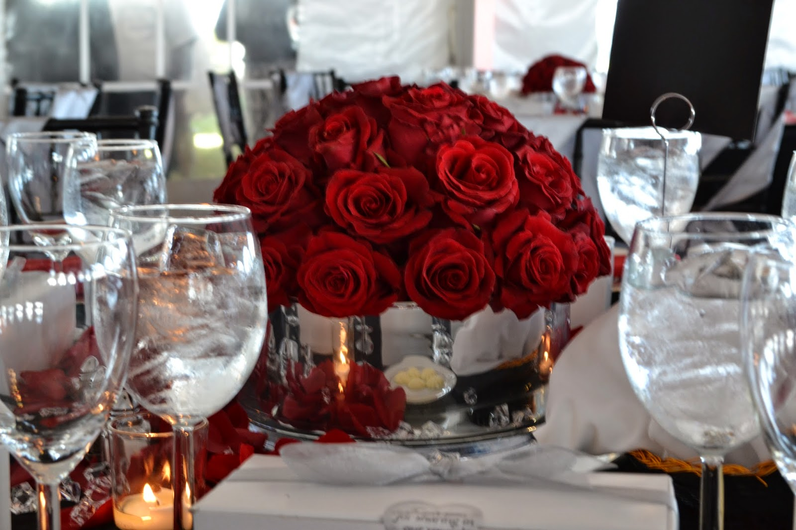 Violet gardens floral designs red silver and black wedding lush red roses called sexy displayed in a low silver cylinder vase reviewsmspy