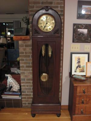 the largest item was an old grandfather clock they quickly came to believe this clock was still connected to their deceased relative - Grandfather Clocks