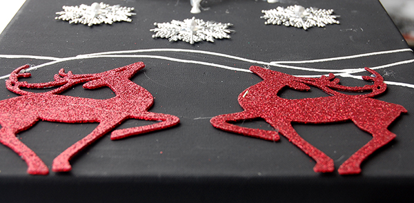 Silver snowflakes, 2 red reindeer ornaments upclose photo