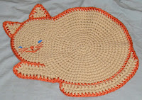 https://winnieswishauction.blogspot.com/2016/08/item-138-orange-cat-mat.html