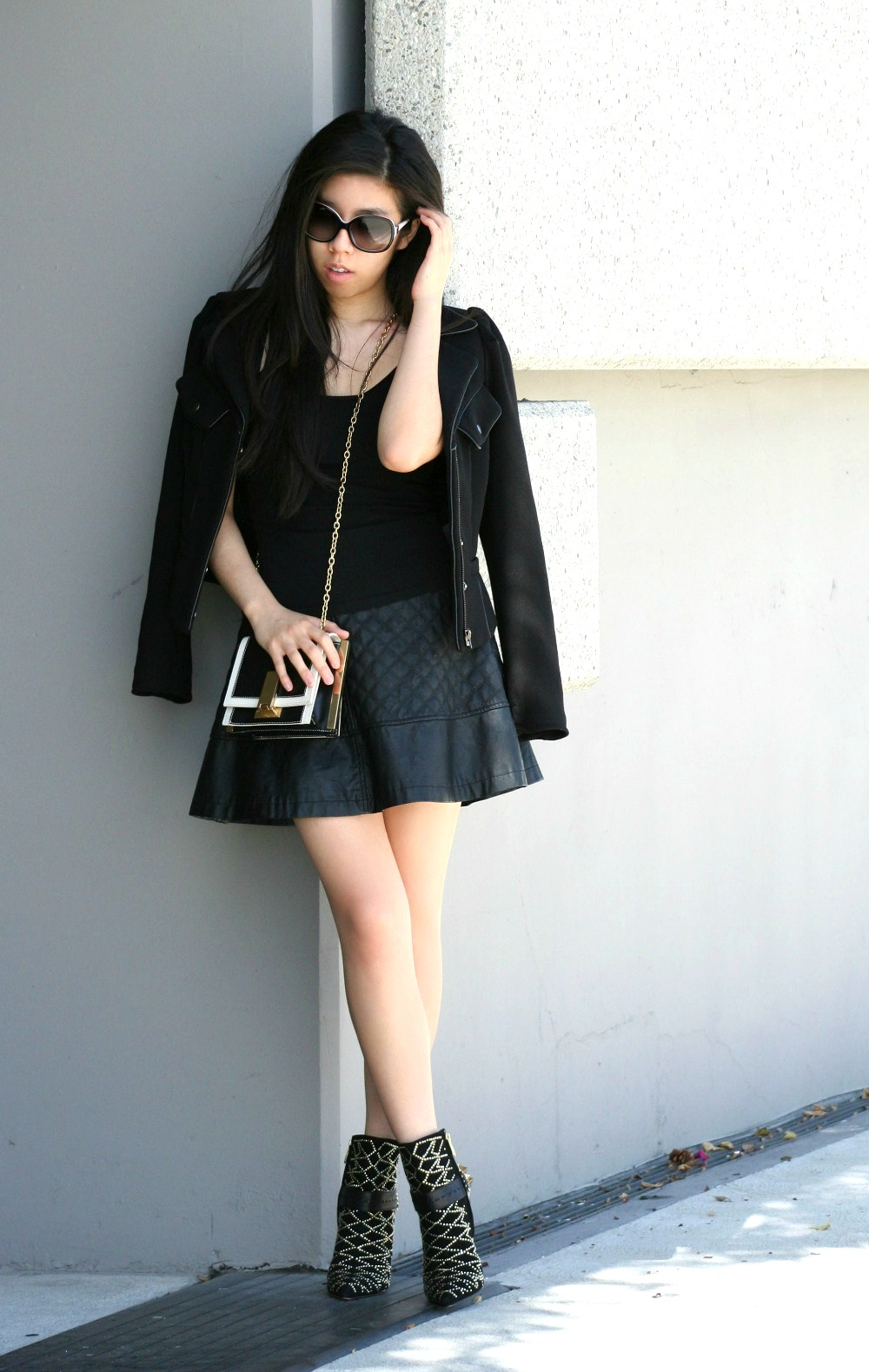 How to Wear a Motorcycle Jacket with A Flare Leather Skirt_Adrienne Nguyen_Invictus