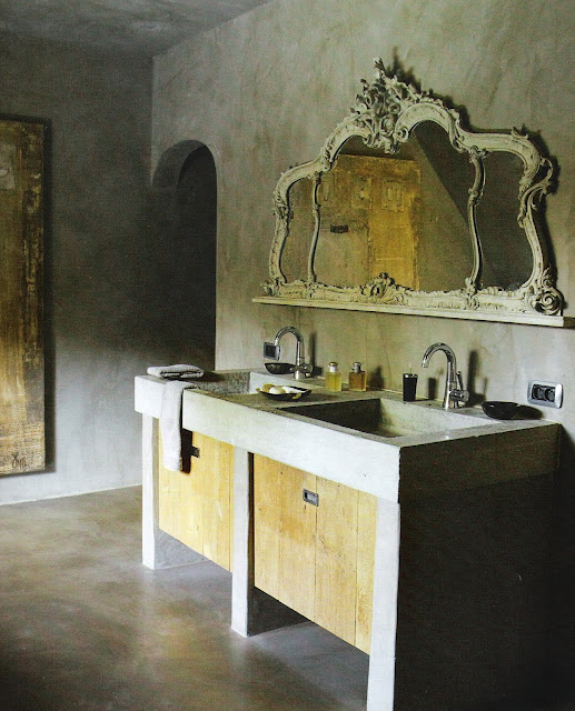romantic carved mirror with concrete and wood vanity, image via Côté Est, Sept-Nov 2009, edited by lb for linenandlavender.net, post:  http://www.linenandlavender.net/2010/01/design-daily.html
