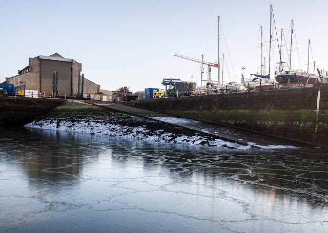 Photo of jigsaw patterns on the ice by the marina slipway
