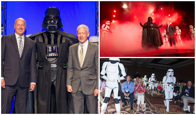 Disney Consumer Products President, Bob Chapek, left, and Lucasfilm Executive Vice President Howard Roffman pose with Darth Vader and 20 Stormtroopers as they take over the stage during a private Disney event at the Licensing Expo, Monday June 17, 2013 at the Mandalay Bay Convention Center in Las Vegas. This surprise grand finale, presented to more than 1,500 licensees, demonstrates a new era of merchandising potential for Disney Consumer Products' robust franchise portfolio, which now includes the Star Wars franchise. (Photo by Eric Jamison/Invision for DisneyConsumer Products/AP Images)