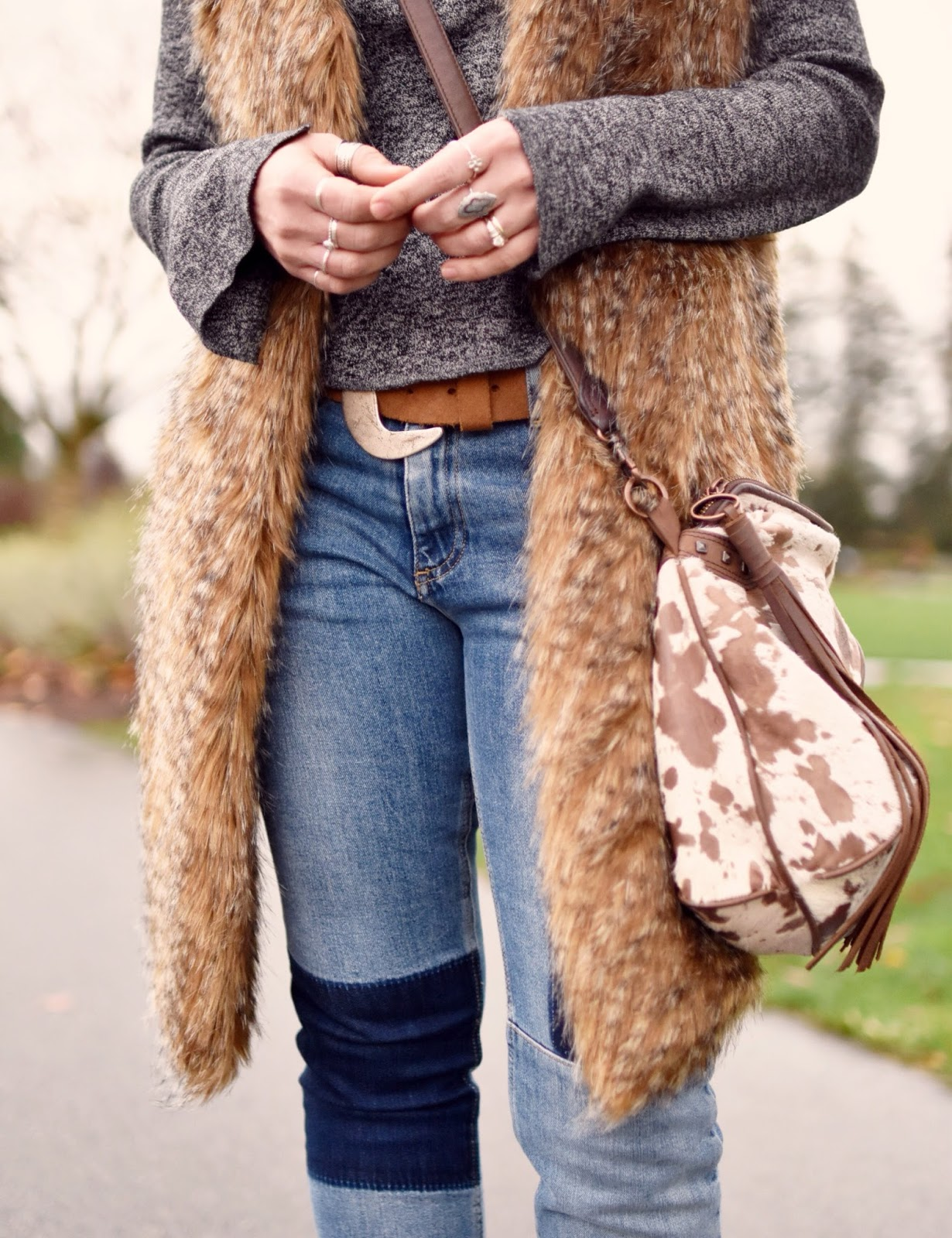 Monika Faulkner outfit inspiration - faux-fur vest, marled grey turtleneck sweater, patchwork skinny jeans, ponyhair cross-body bag