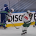 Elias Pettersson clocks Ryan Hartman in back of head