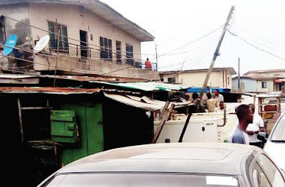 Lagos residents panic as high tension cables droop on houses