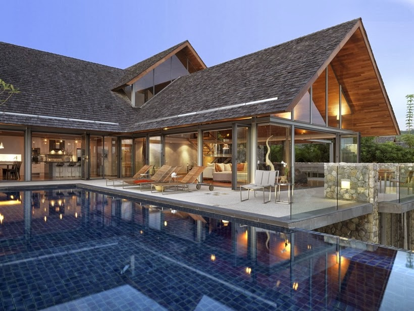 Swimming pool and terrace in Villa with contemporary Asian design