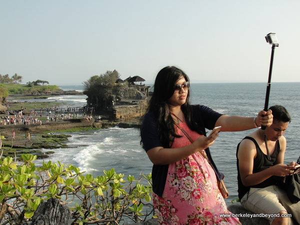 taking selfies at Tanah Lot temple in Bali, Indonesia