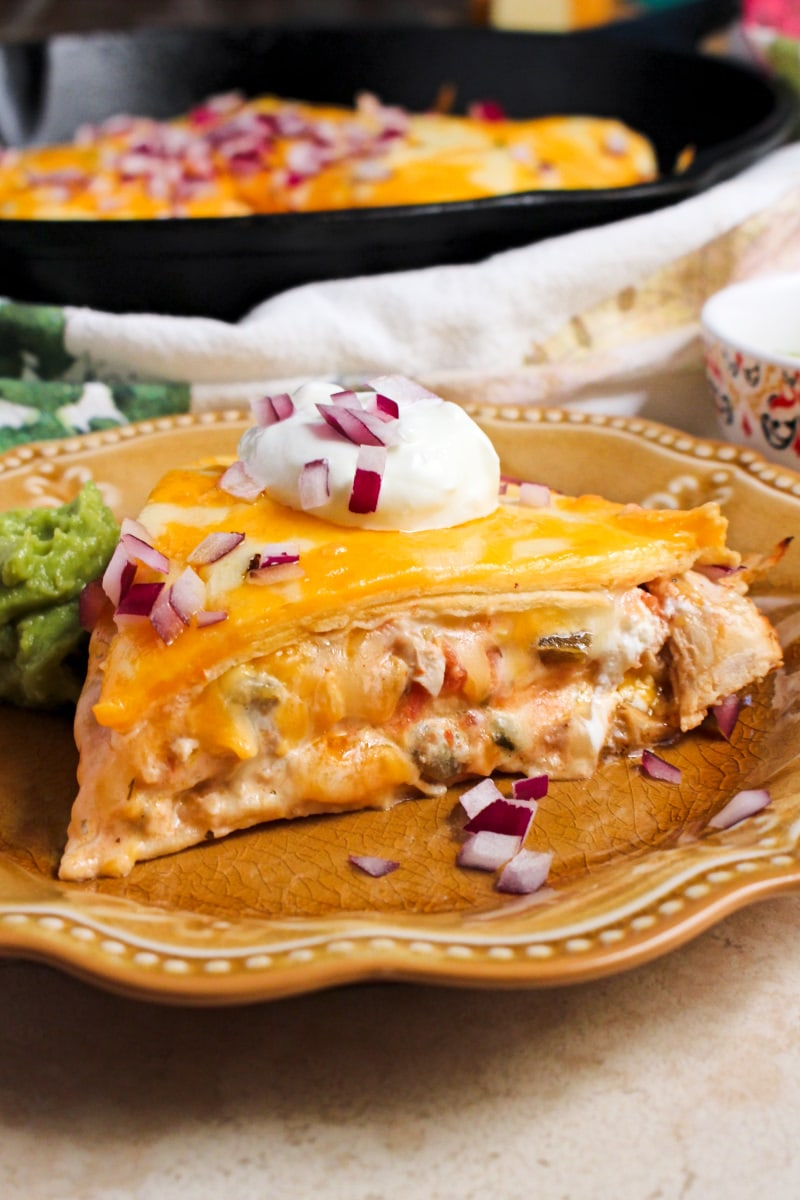 Cheesy Chicken Tortilla Pie is made with layers of flour tortillas, shredded chicken, salsa, plain greek yogurt and lots of melty, delicious cheese.  You will love how quickly this easy dinner recipe comes together! #chickenrecipe #mexicanfood #casserole