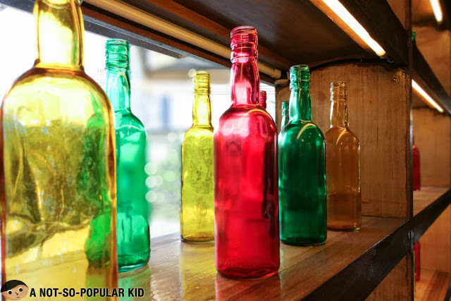 Colorful bottles at the rack - Peri-peri Chicken