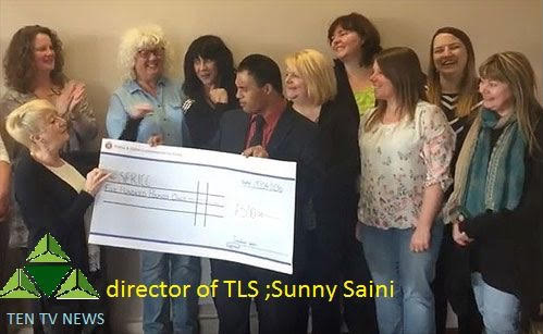 Thurrock Lifestyle Solutions director Sunny Saini handing over a giant cheque to the ladies working at SERICC in Thurrock.