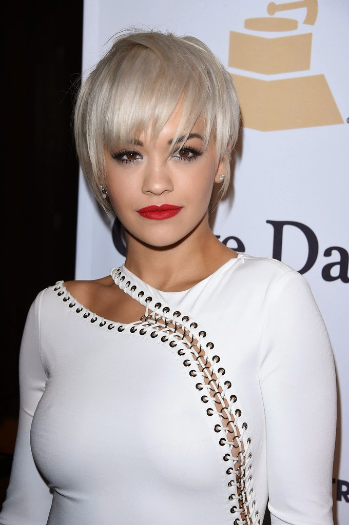 Rita Ora in a glamorous white gown at the Annual Clive Davis Pre-Grammys Gala in Beverly Hills