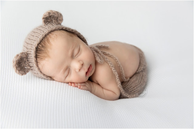 Sleeping baby wearing a knitted hat with ears