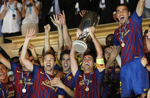 Barcelona players celebrate after winning the European Super Cup