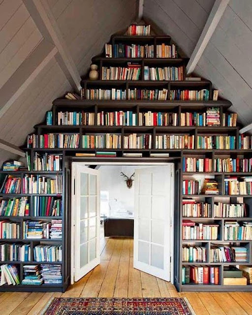 I just love this amazing book wall! I'd never get anything done but reading!