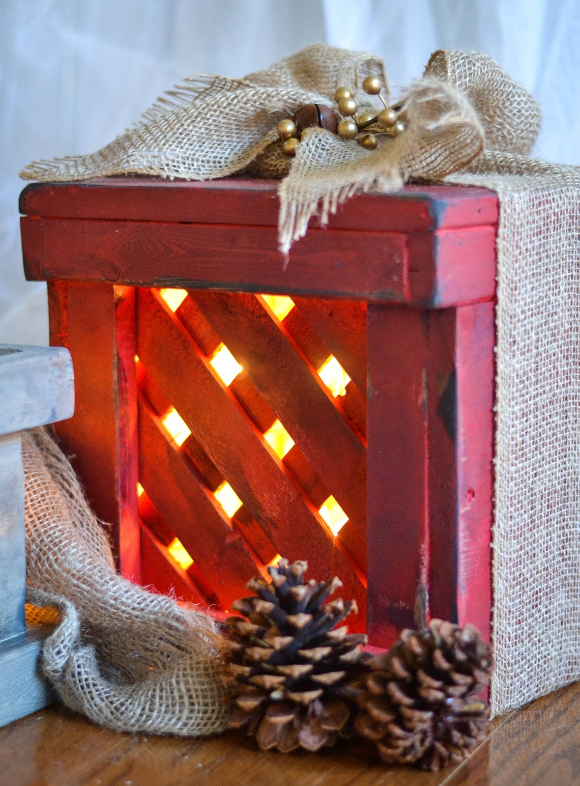 last year i made some wooden gifts for our front porch and the twinkle lights inside were a festive and fun welcome - Wooden Box Christmas Decorations