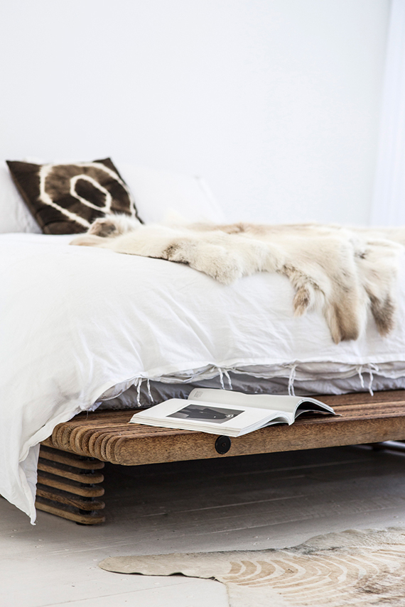 Platform bed with furry throw in the home of Oracle Fox. Photo by Amanda Shadforth