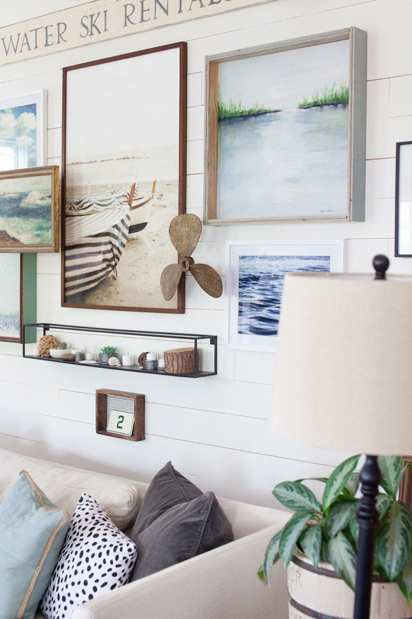 Gallery wall of beach items from The Lettered Cottage