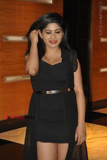 Telugu Actress Model Madhulagna Das Latest Spicy Stills in Black Short Dress  0015.JPG