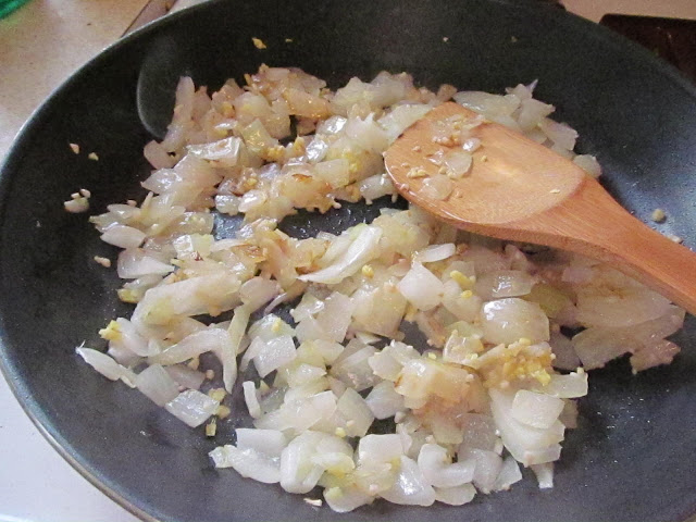 onions, ginger, and garlic in a frying pan