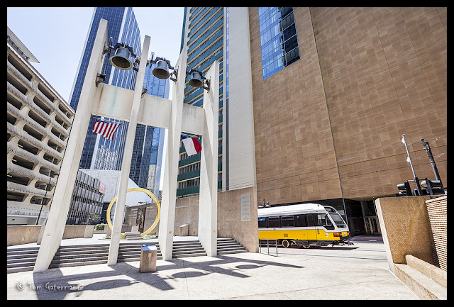 A DART Train Rolling Past the Bells at Thanks-Giving Square in Dallas, TX.