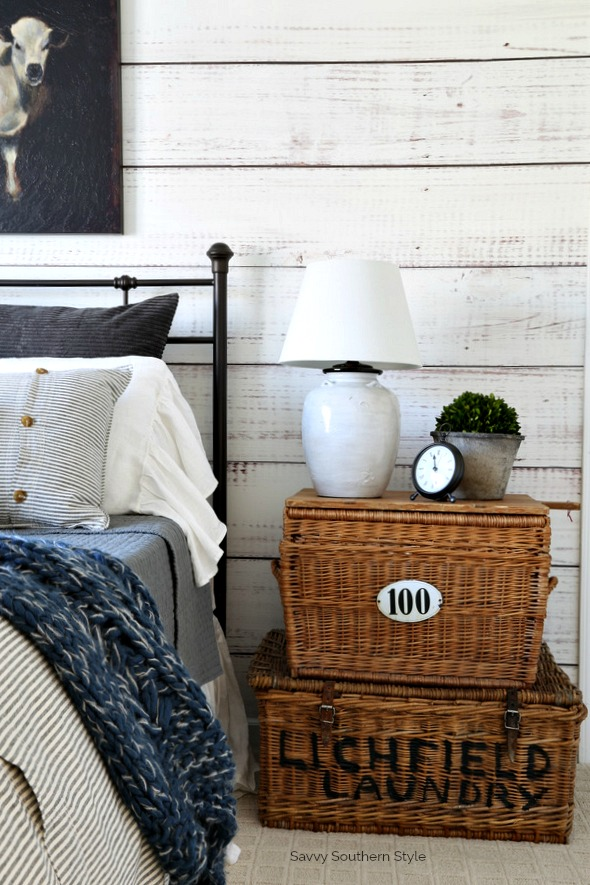 wicker baskets in farmhouse style bedroom