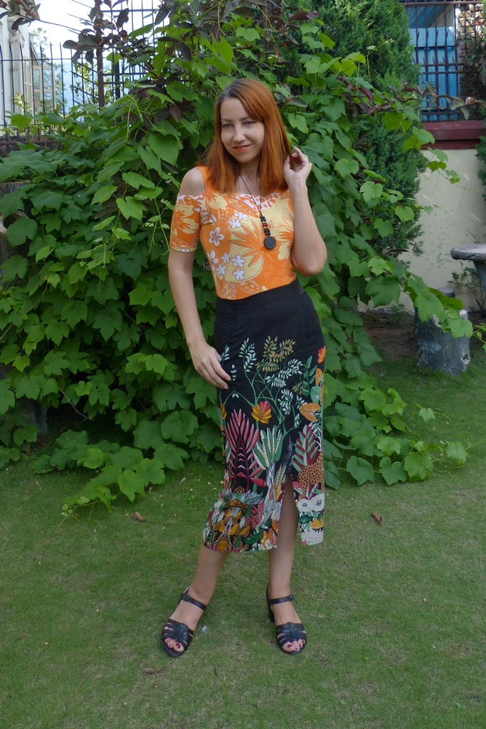 Cold shoulder top with jungle print pencil skirt