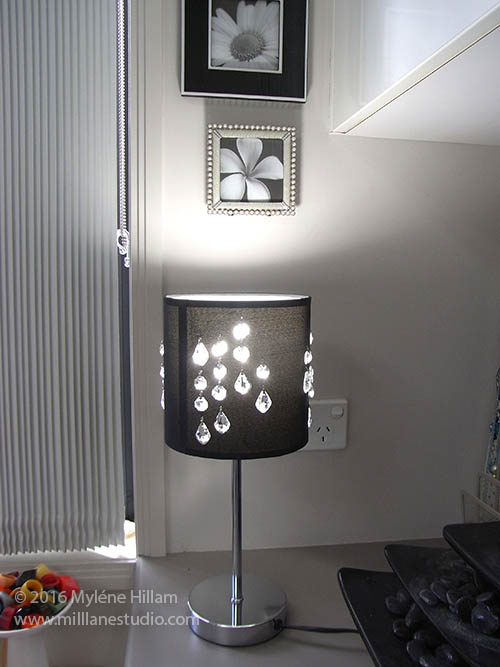 Black lampshade inset with clear baroque and octagonal Swarovski crystals.