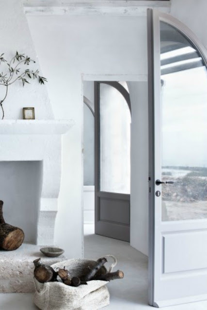 Arched doors in an Italian Farmhouse - found on Hello Lovely Studio