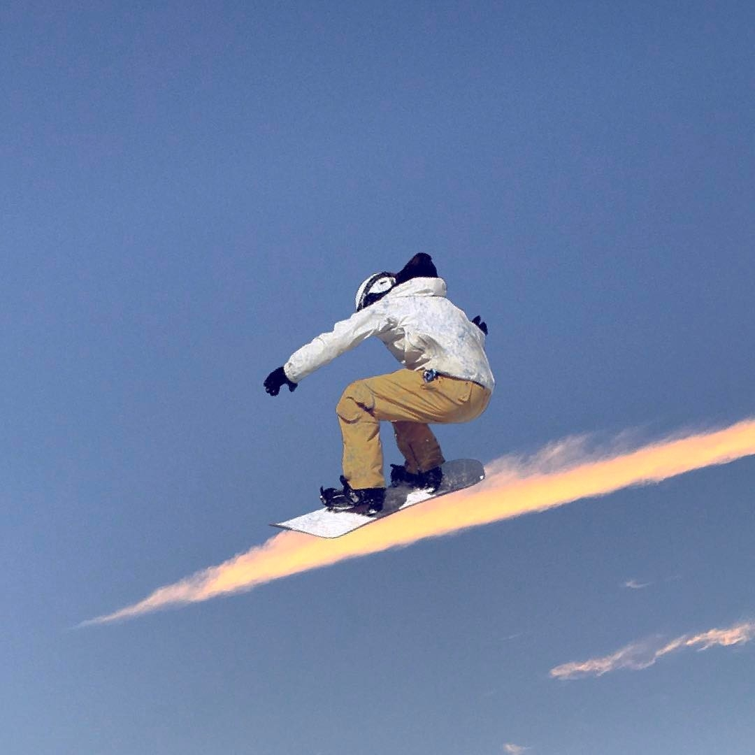 02-Snowboarding-Marcus-Einspannier-Surreal-Digital-Photo-Manipulation-using-Clouds-www-designstack-co