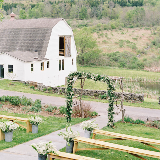 The altar and seating for Jonna and Heather's Inn at West Settlement Wedding by Karen Hill Photography