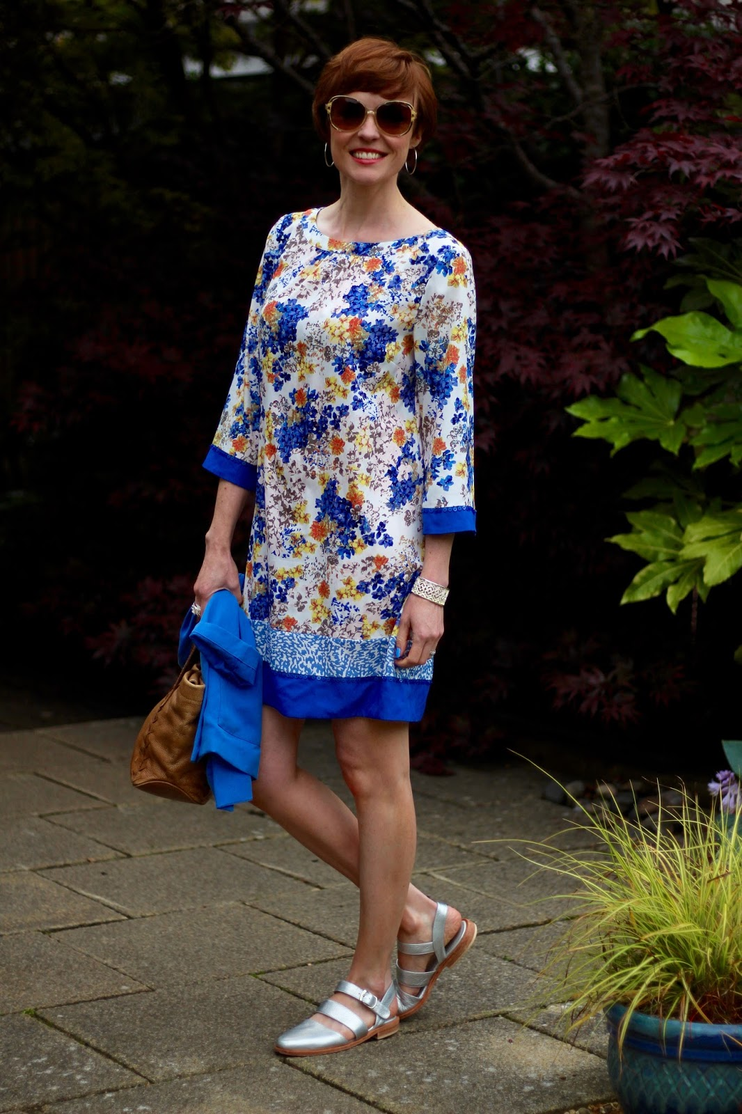 Fake  Fabulous |Wardrobe malfunction, clinging fabrics | Blue, yellow and orange floral dress & silver sandals