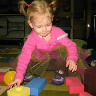 A toddler playing with blocks