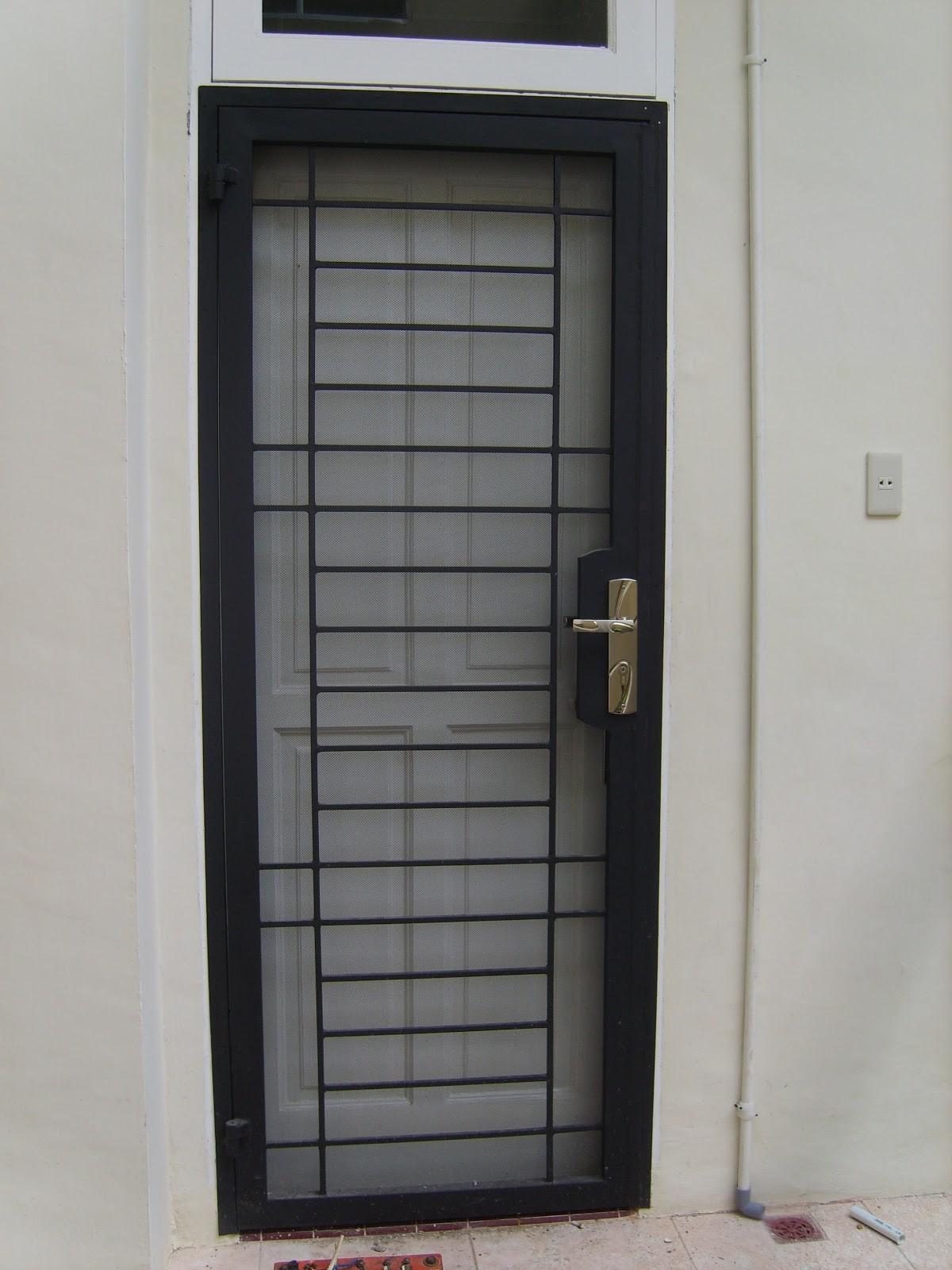 Gambar Pintu Utama Teralis Besi Tempa