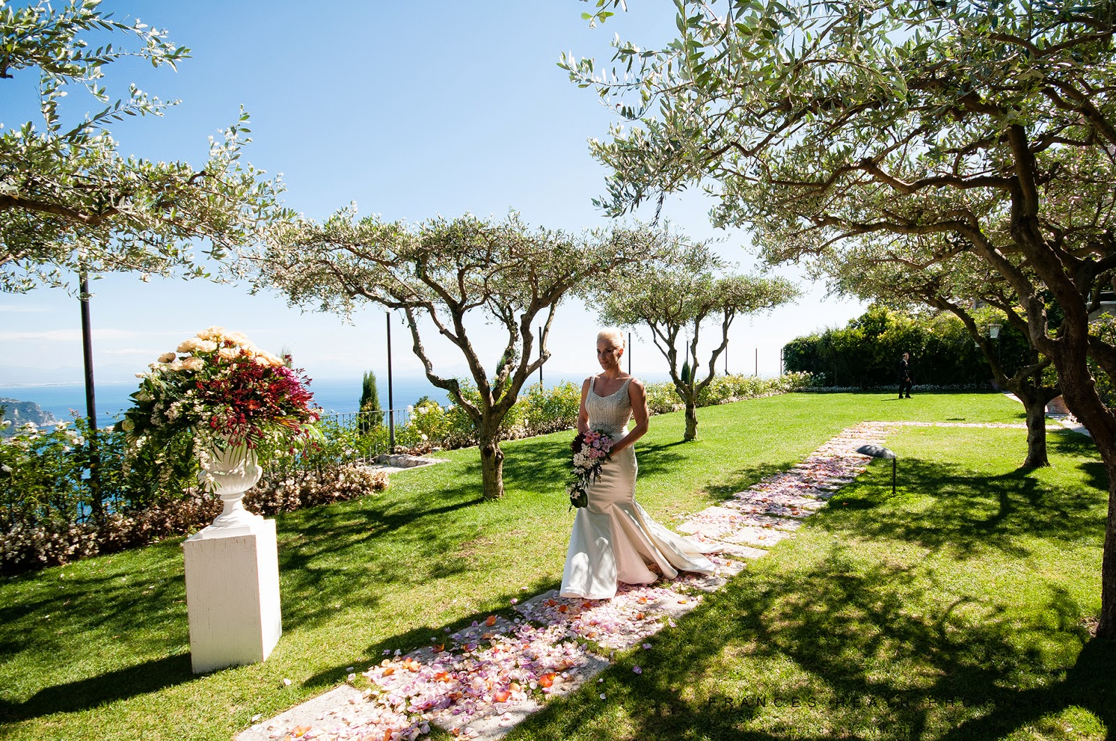 Bride walking down the aisle in Hotel Caruso Ravello