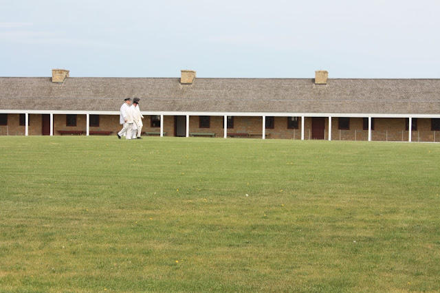 Interpreters organizing on the parade ground at Fort Snelling