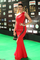 Meenakshi Dixit in Red One Shoulder Red Zipped up gown at IIFA Utsavam Award 82.JPG