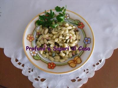 gnocchetti sardi freschi con funghi , zucchine e dadini di prosciutto